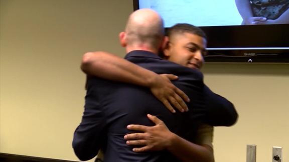 FBI Special Agent Troy Sowers and U.S. Marine Cpl. Stewart Rembert hug in 2019. (Credit: CNN)