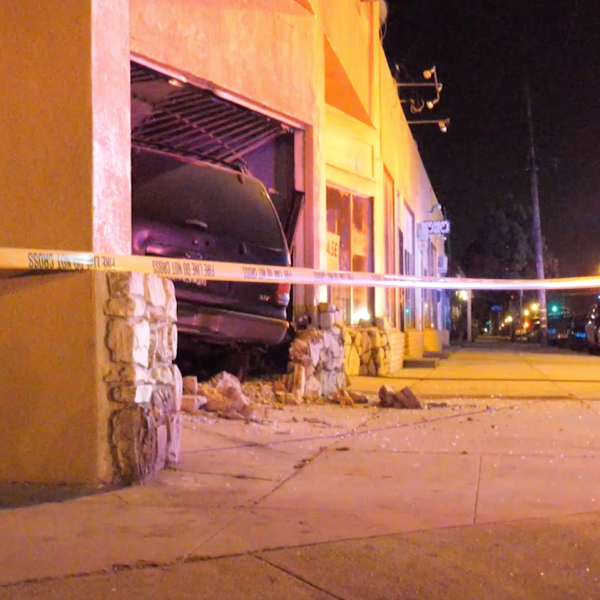 An SUV sits inside an apartment building after a crash on Aug. 1, 2019. (Credit: ONSCENE.TV)