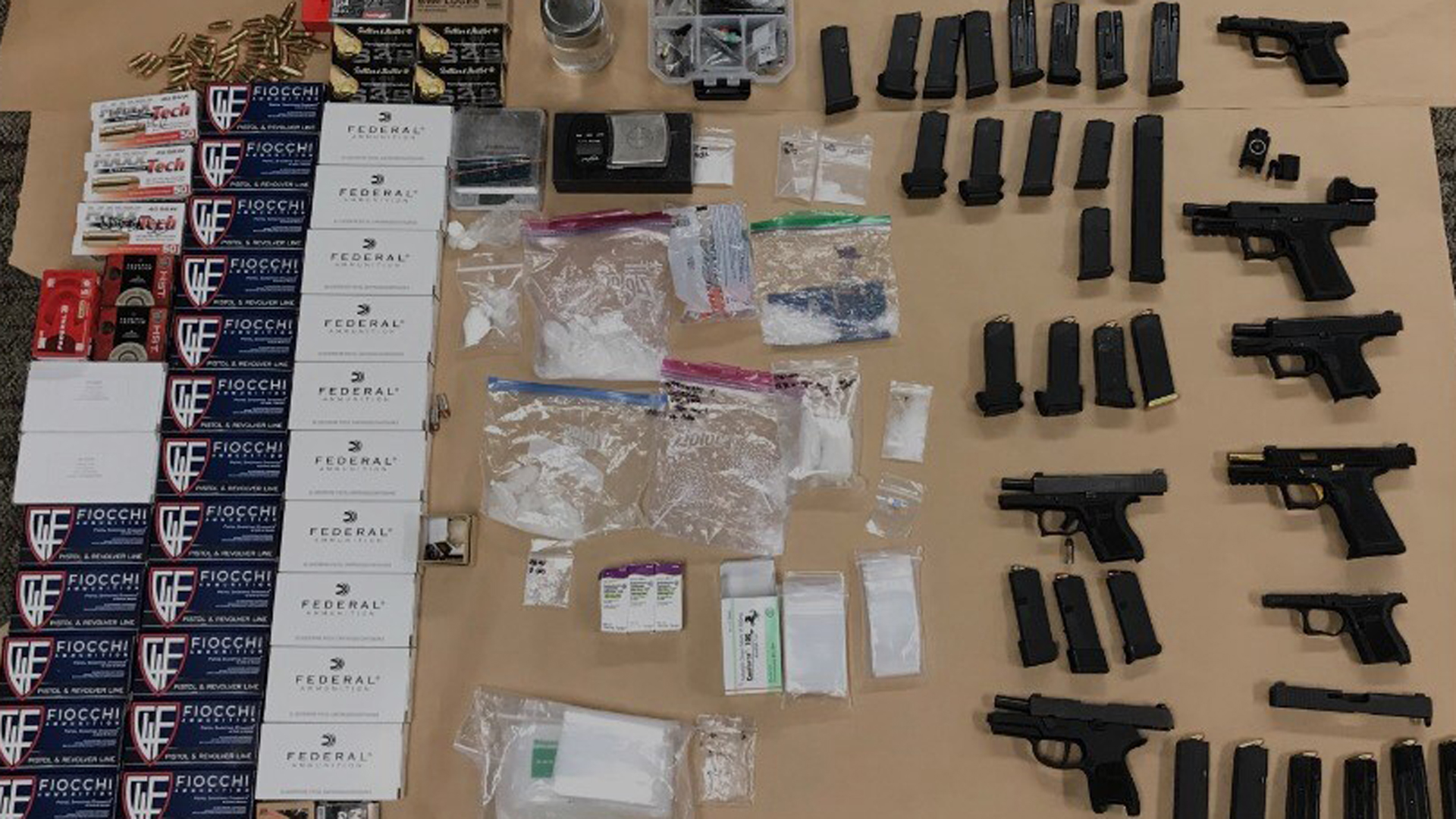 Fountain Valley police seized 6 handguns, ammunition, fentanyl, methamphetamine and other drugs from the home of a convicted felon in HuntingtonBeach onAug. 26, 2019. (Credit: Fountain Valley Police Department)