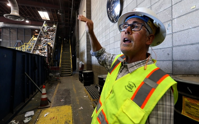 """We just don't have a market for a lot of this stuff,"" said Kreigh Hampel, recycling coordinator for the city of Burbank. The California recycling industry has struggled after China stopped accepting certain kinds of recycled materials. (Credit: Carolyn Cole / Los Angeles Times)"