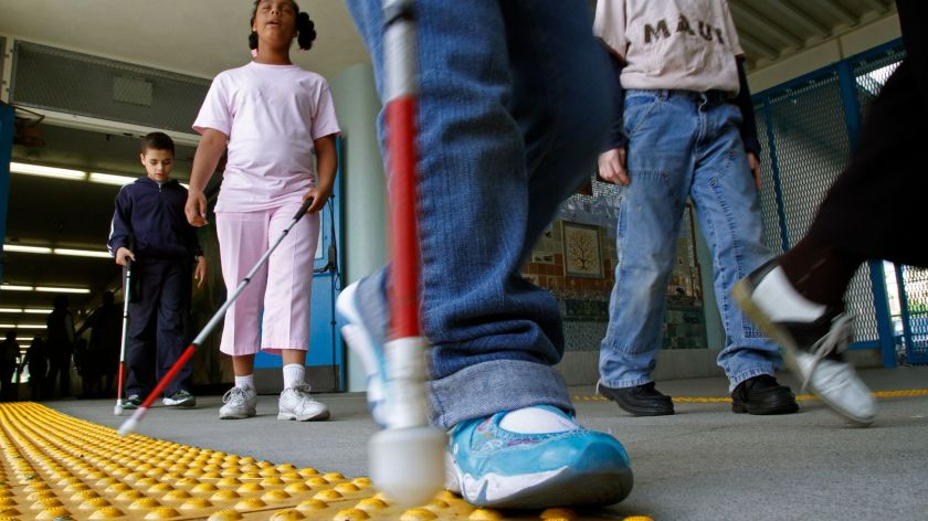Bumpy surfaces help blind students navigate through an L.A. Unified campus in Hollywood in 2010.(Credit: Don Bartletti / Los Angeles Times)