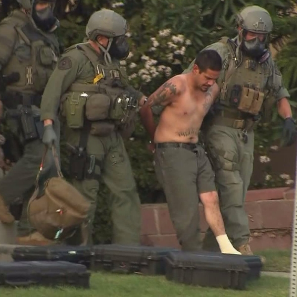 David Carrillo is taken into custody following a lengthy standoff at a Santa Monica home on Feb. 21, 2015. (Credit: KTLA)