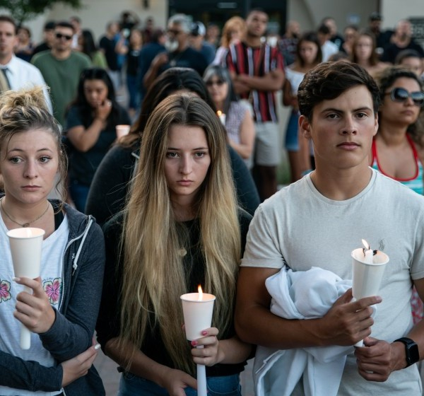 Mourners are seen during a candlelight vigil at Gilroy City Hall. (Credit: Kent Nishimura/Los Angeles Times)