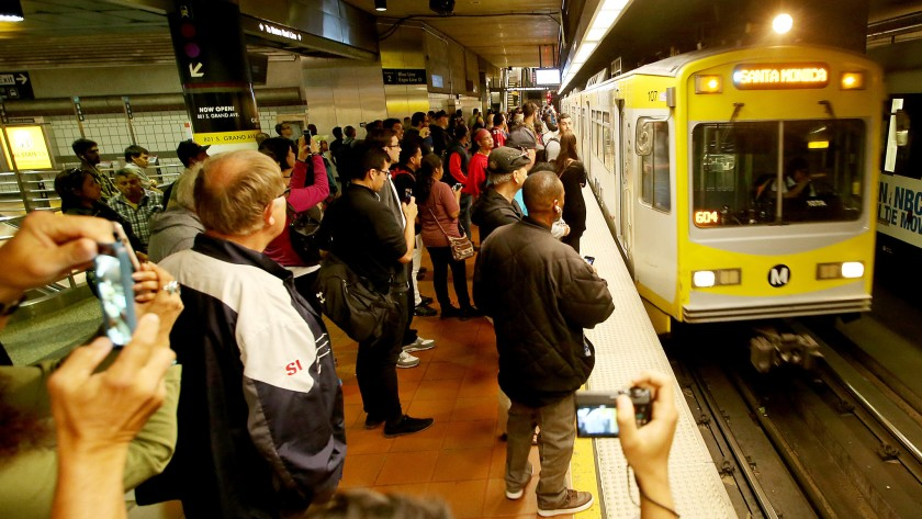 A crowd waits as an Expo Line train pulls in at 7th Street/Metro Center downtown in 2016.(Credit: Luis Sinco / Los Angeles Times)