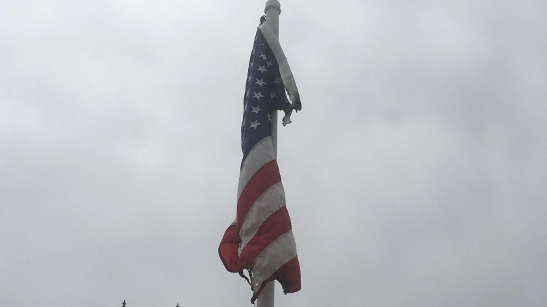 A burned American flag hanging at the Balboa Island bridge in Newport Beach. (Credit: Jack Callahan/ Balboa Island Improvement Assn. via Los Angeles Times)
