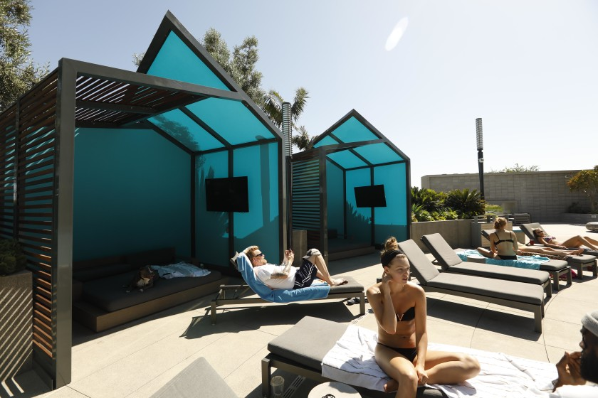 Tenants enjoy custom-designed cabanas and one of two pools at the Circa complex on Figueroa Street in downtown Los Angeles in this undated photo.(Credit: Genaro Molina / Los Angeles Times)
