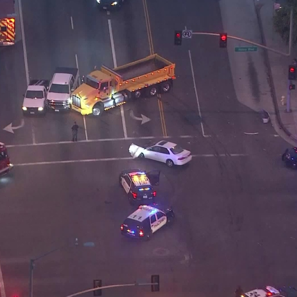 Authorities surround a yellow dump truck in Alhambra after a pursuit on Aug. 12, 2019. (Credit: Sky5)