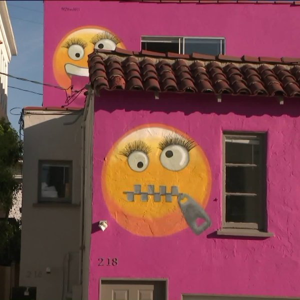 A duplex painted pink and adorned with emojis, pictured on Aug. 2, 2019, is at the center of a neighborhood controversy in Manhattan Beach.