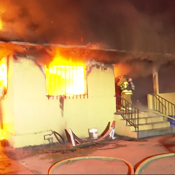 Firefighters respond to a house fire in Exposition Park on Aug. 22, 2019. (Credit: OnScene.TV)