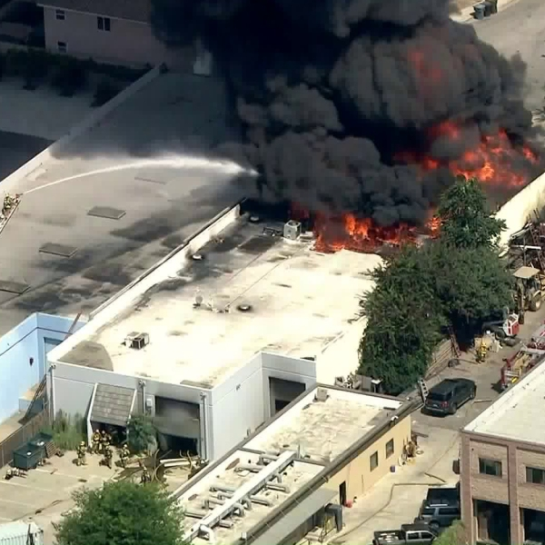 Firefighters battle a massive blaze at a commercial fire in Paramount on Aug. 19, 2019. (Credit: KTLA)