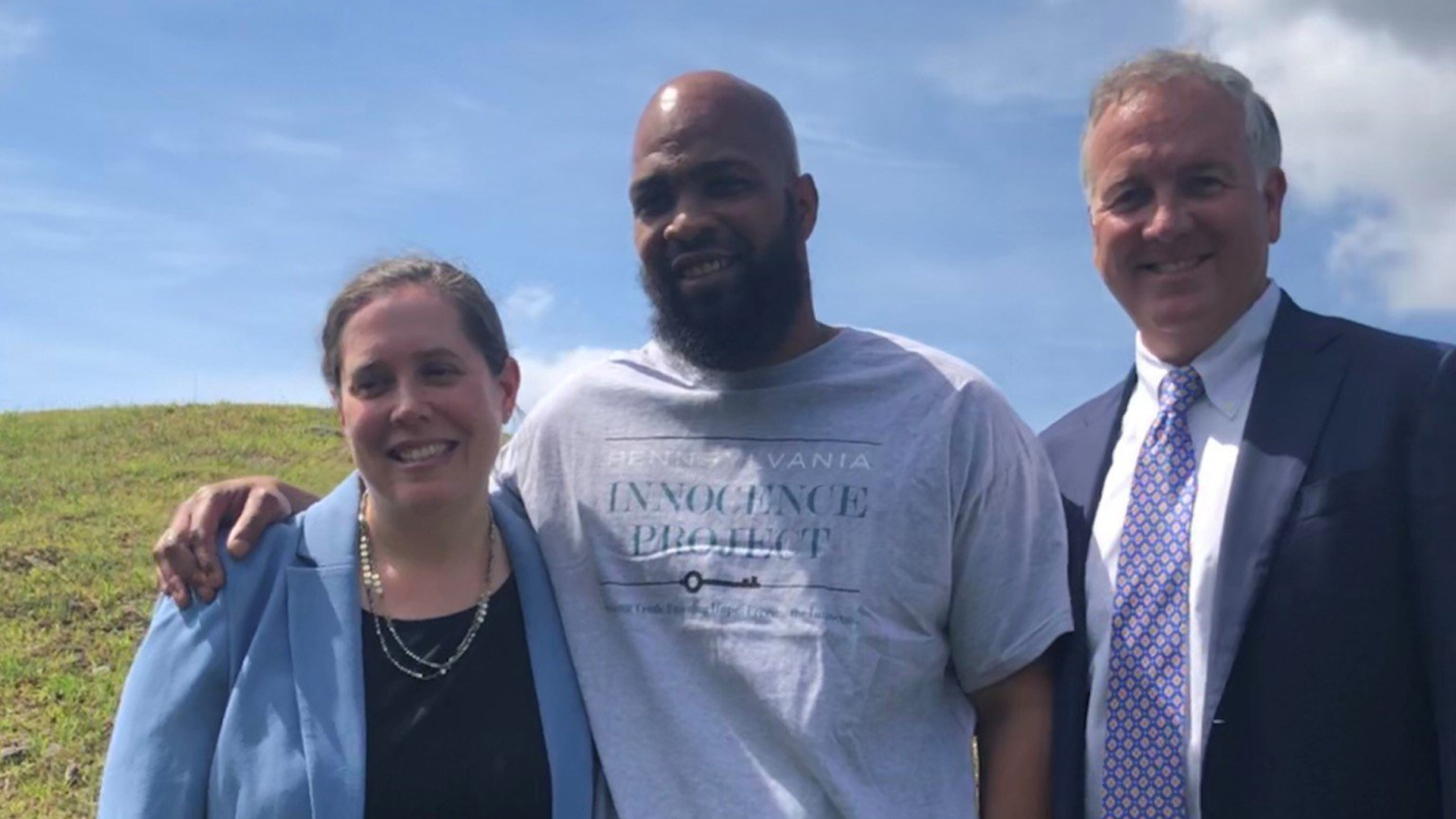 John Miller, center, is seen here with Pepper Hamilton attorneys outside the prison following his release. (Credit: CNN)