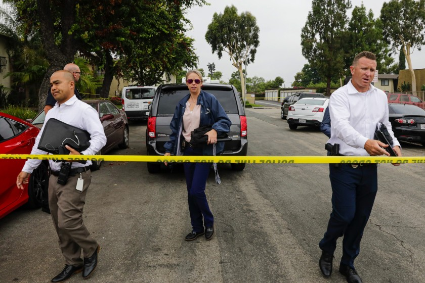 Police investigators work at the Casa De Portola apartment complex in Garden Grove where the first two victims in a stabbing rampage were attacked on Aug. 7, 2019. (Credit: Irfan Khan/Los Angeles Times)