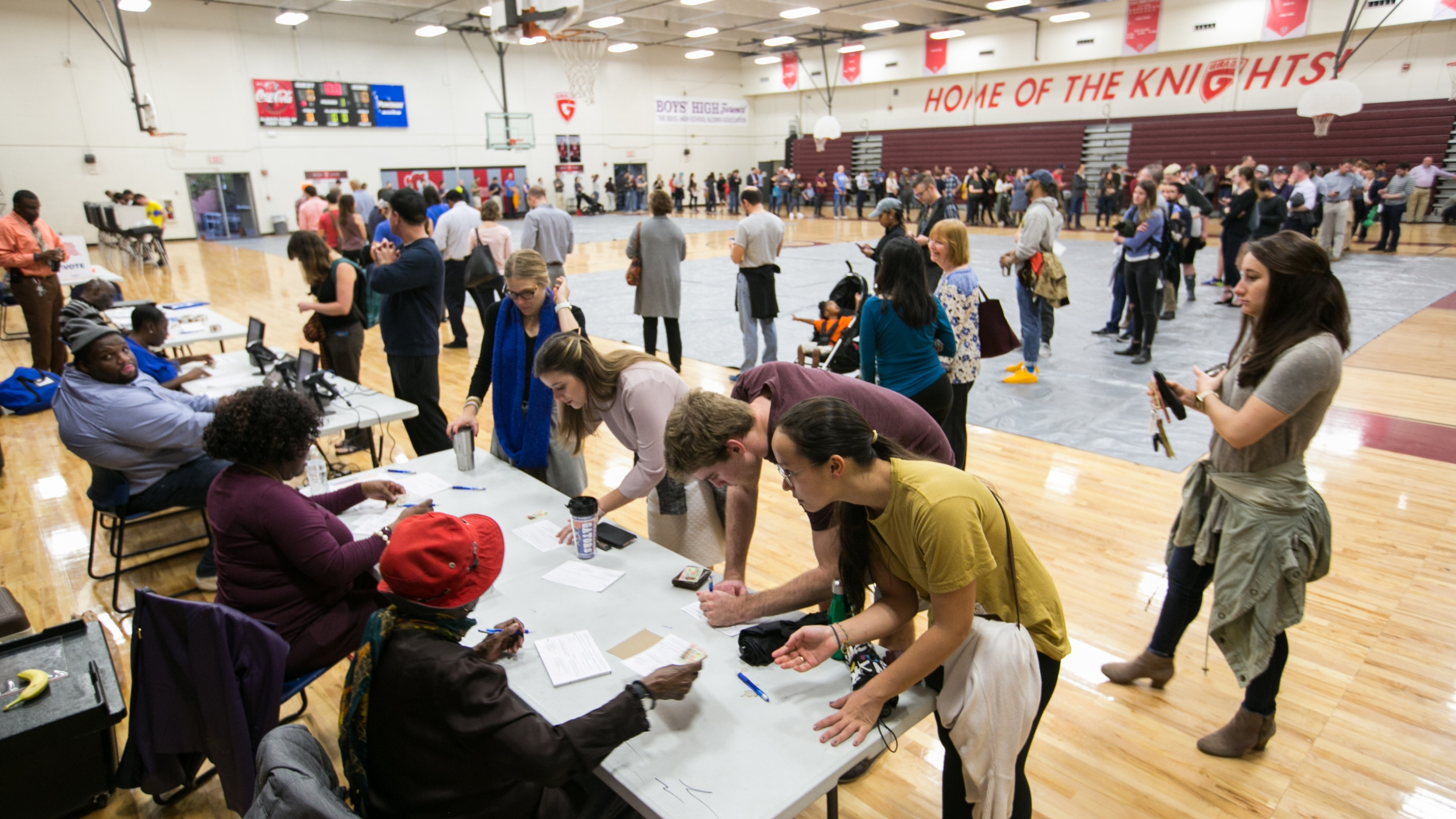 Voters line up to cast their ballots at a polling station set up at Grady High School for the mid-term elections on Nov. 6, 2018, in Atlanta, Georgia. (Credit: Jessica McGowan/Getty Images)