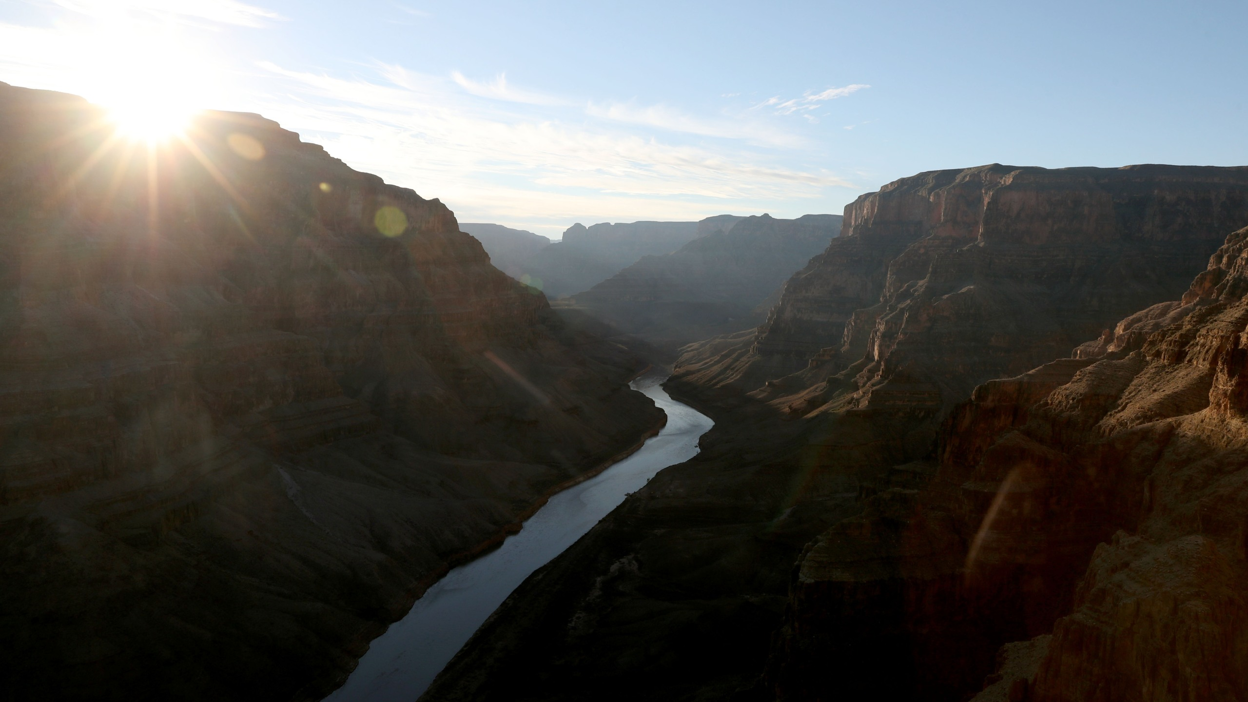 The Colorado River winds its way along the West Rim of the Grand Canyon in the Hualapai Indian Reservation on January 10, 2019 near Peach Springs, Arizona. (Credit: Justin Sullivan/Getty Images)