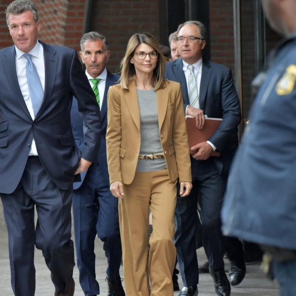 Lori Loughlin exits a federal courthouse in Boston after appearing to face charges in the college admissions scandal on April 3, 2019. (Credit: Paul Marotta / Getty Images)