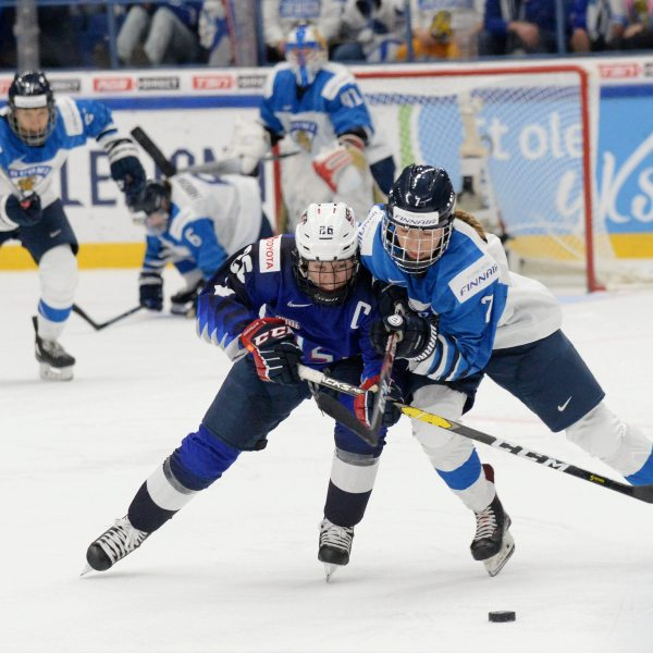 Kendall Coyne Schofield (L) of the United States and Nelli Laitinen of Finland vie during the IIHF Women's Ice Hockey World Championships final match between the United States and Finland in Espoo, Finland, on April 14, 2019. (Credit: MIKKO STIG/AFP/Getty Images)