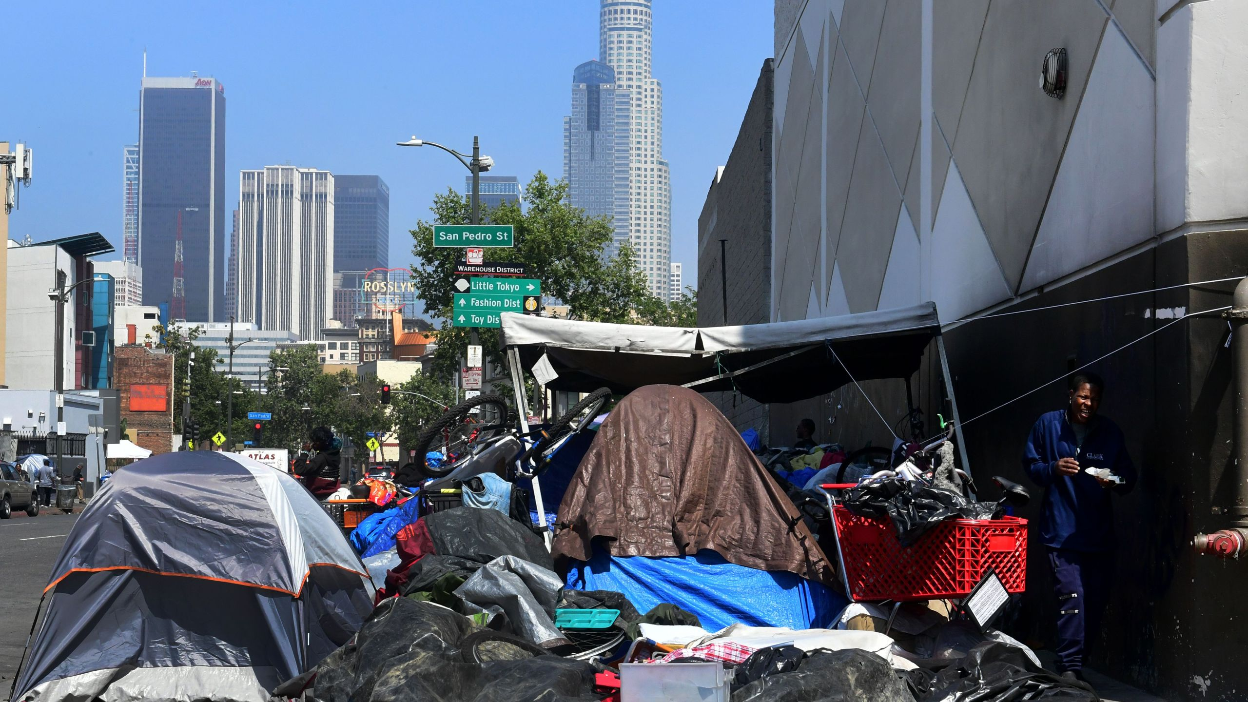 Belongings of the homeless are seen on a downtown L.A. sidewalk on Skid Row on May 30, 2019. (Credit: FREDERIC J. BROWN/AFP/Getty Images)