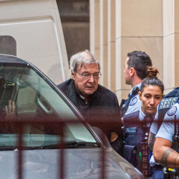 Australian Cardinal George Pell is escorted into the Supreme Court of Victoria in Melbourne on June 6, 2019. (Credit: ASANKA BRENDON RATNAYAKE/AFP/Getty Images)