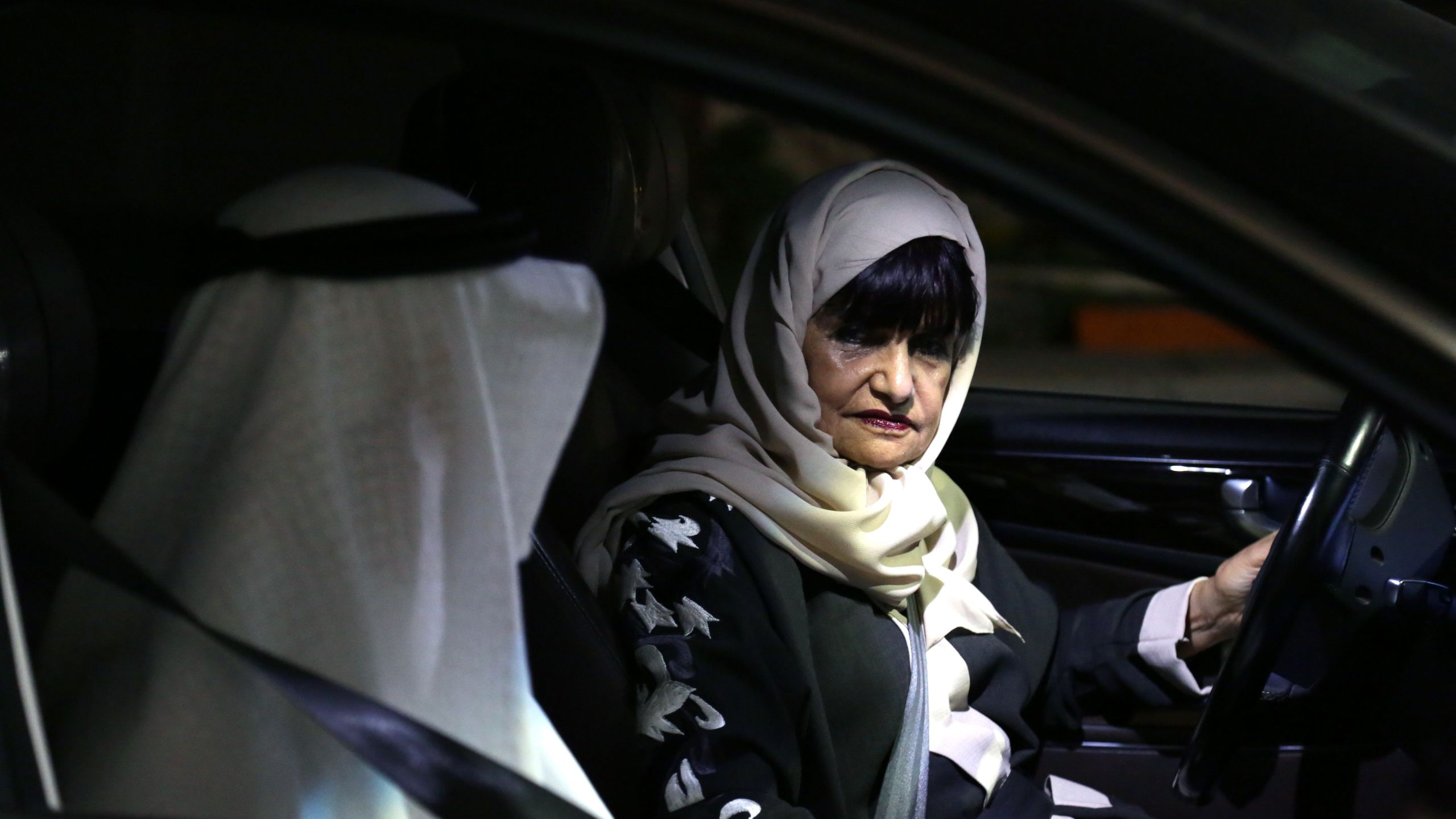 Munirah al-Sinani, a 72-year-old Saudi woman, accompanied by her husbad, is pictured in her car in the eastern Saudi city of Dhahran on June 11, 2019. Until June 24, 2018, driving for women would have been considered a crime in Saudi Arabia, where hardliners have preached for decades that allowing the act would promote gender mixing and promiscuity. (Credit: MOHAMMED AL-NEMER/AFP/Getty Images)