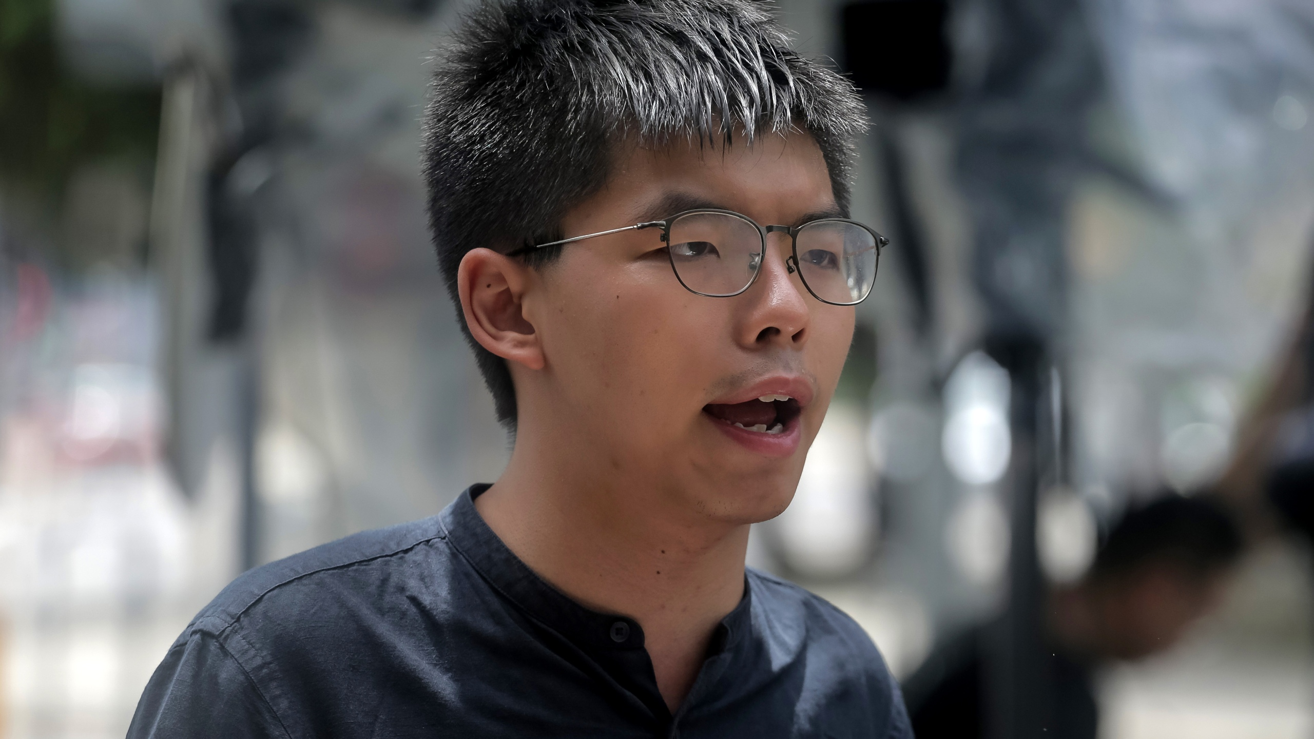 Pro-democracy activist Joshua Wong speaks to media outside the government headquarters in Hong Kong on July 2, 2019, a day after protesters broke into the building. (Credit: Vivek Prakash / AFP / Getty Images)