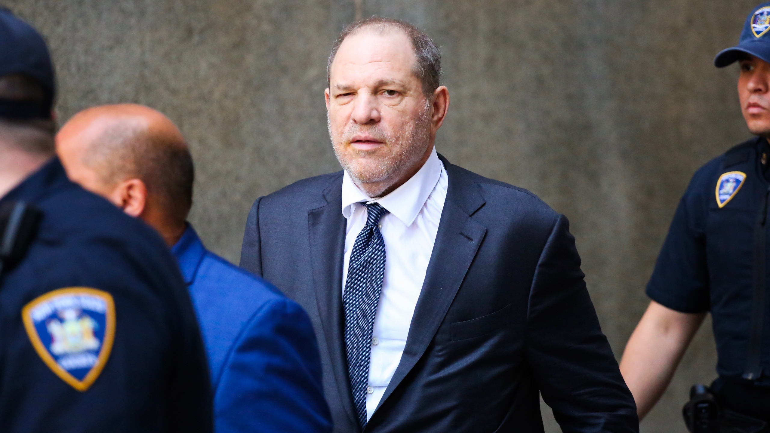 Disgraced movie mogul Harvey Weinstein exits after his appearance in criminal court on sexual assault charges on July 11, 2019, in New York City. (Credit: Kena Betancur/Getty Images)