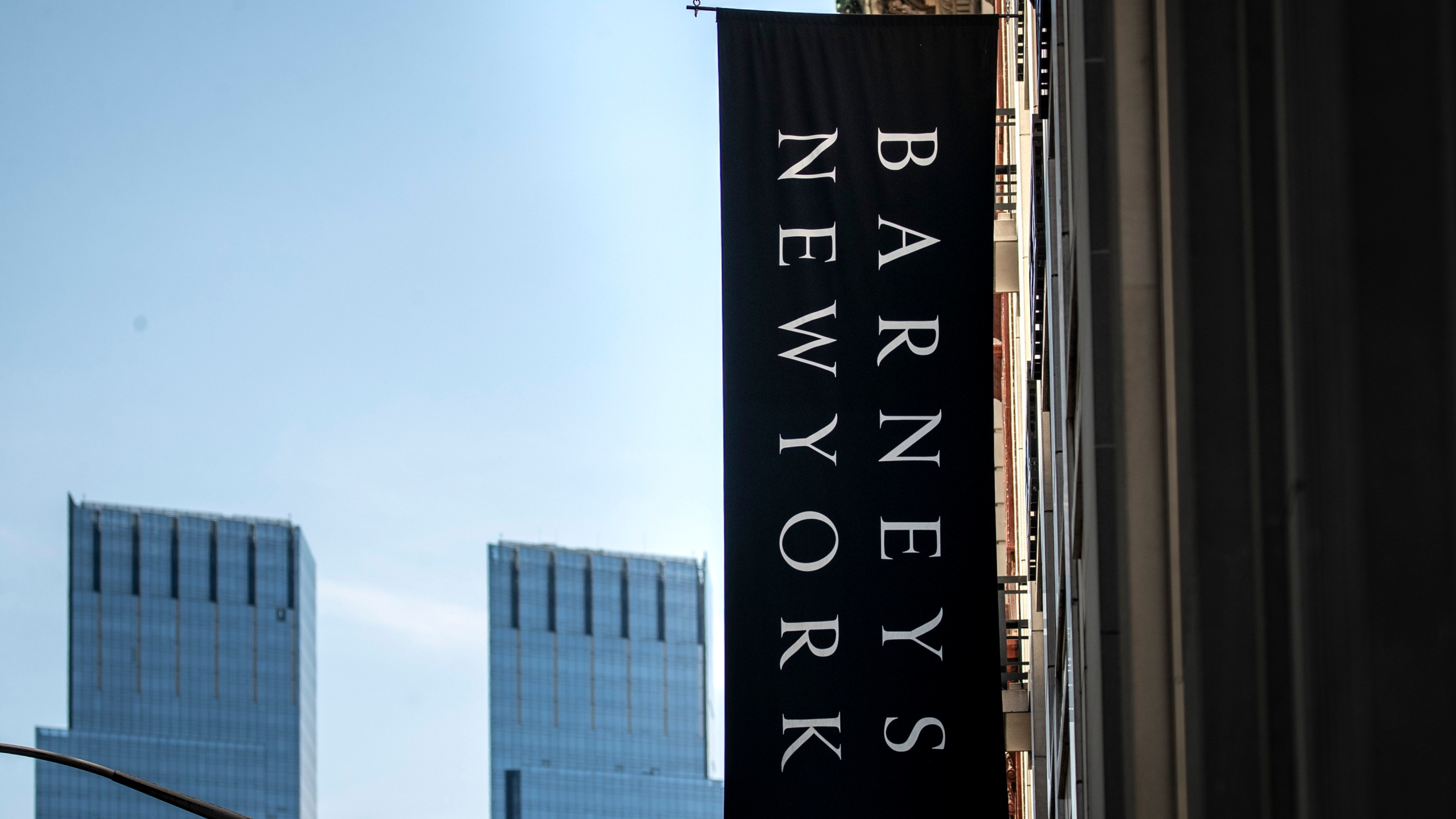Signage for Barneys New York hangs on the side of the store in Midtown Manhattan, July 15, 2019 in New York City. (Credit: Drew Angerer/Getty Images)
