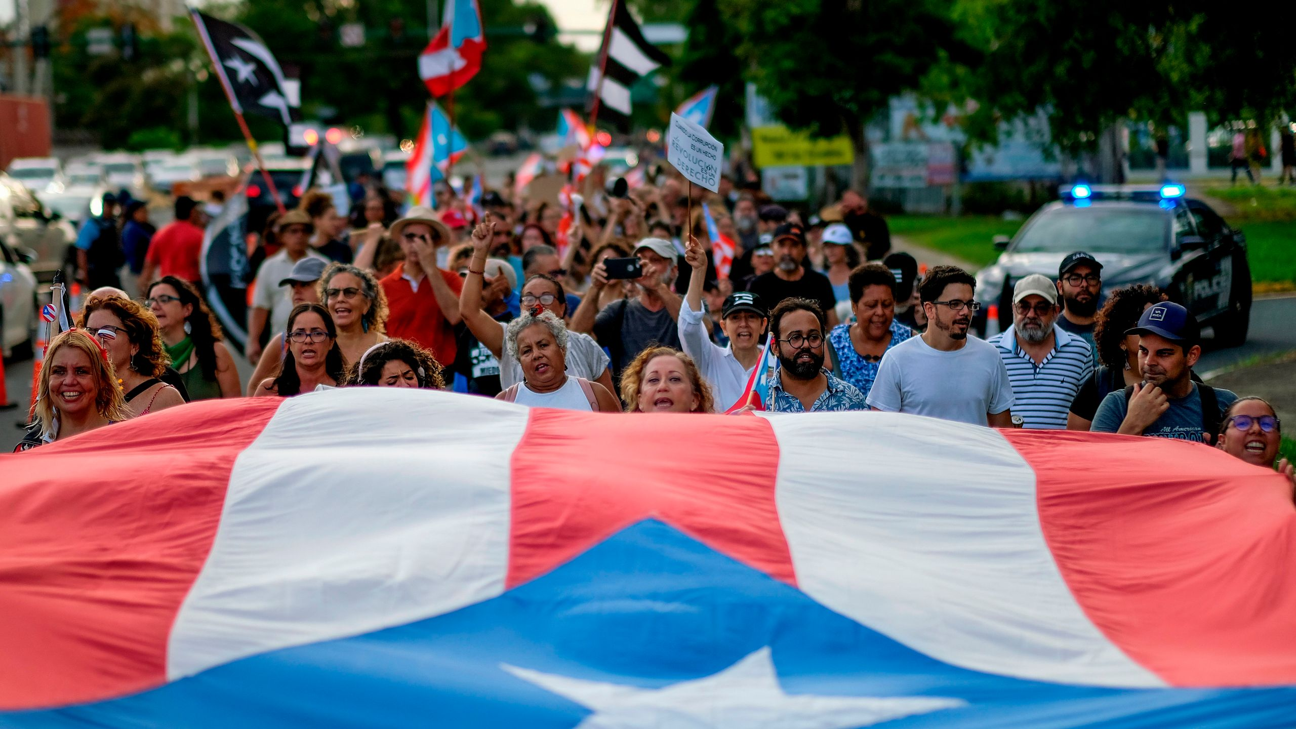 People march in protest in San Juan on July 29, 2019, against Wanda Vazquez, Puerto Rico's current Secretary of Justice, possibly becoming governor. She later rejected the job. (Credit: RICARDO ARDUENGO/AFP/Getty Images)