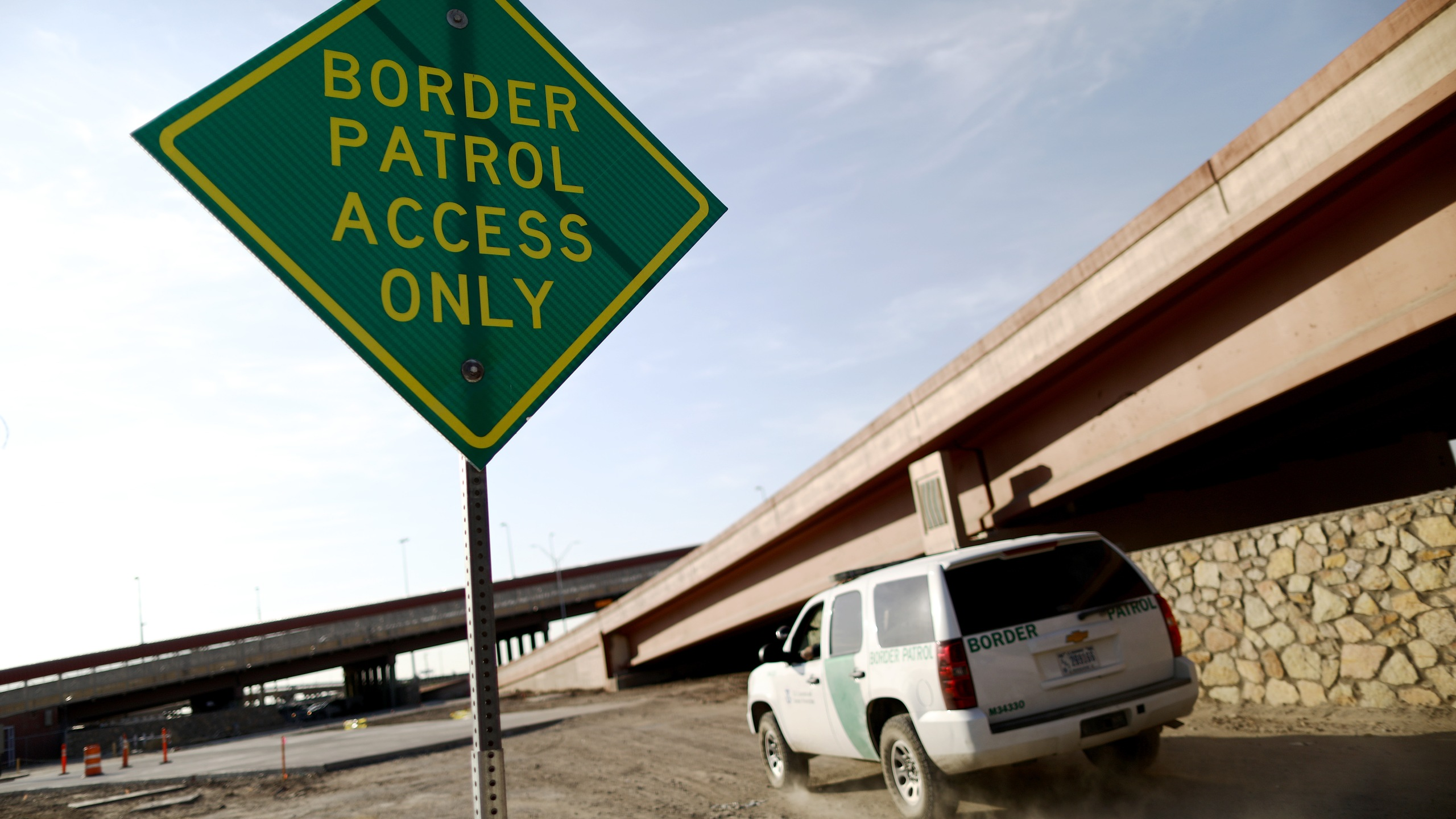 A U.S. Border Patrol vehicle passes a 'Border Patrol Access Only' sign near the U.S.-Mexico border on June 26, 2019, in El Paso, Texas. (Credit: Mario Tama/Getty Images)