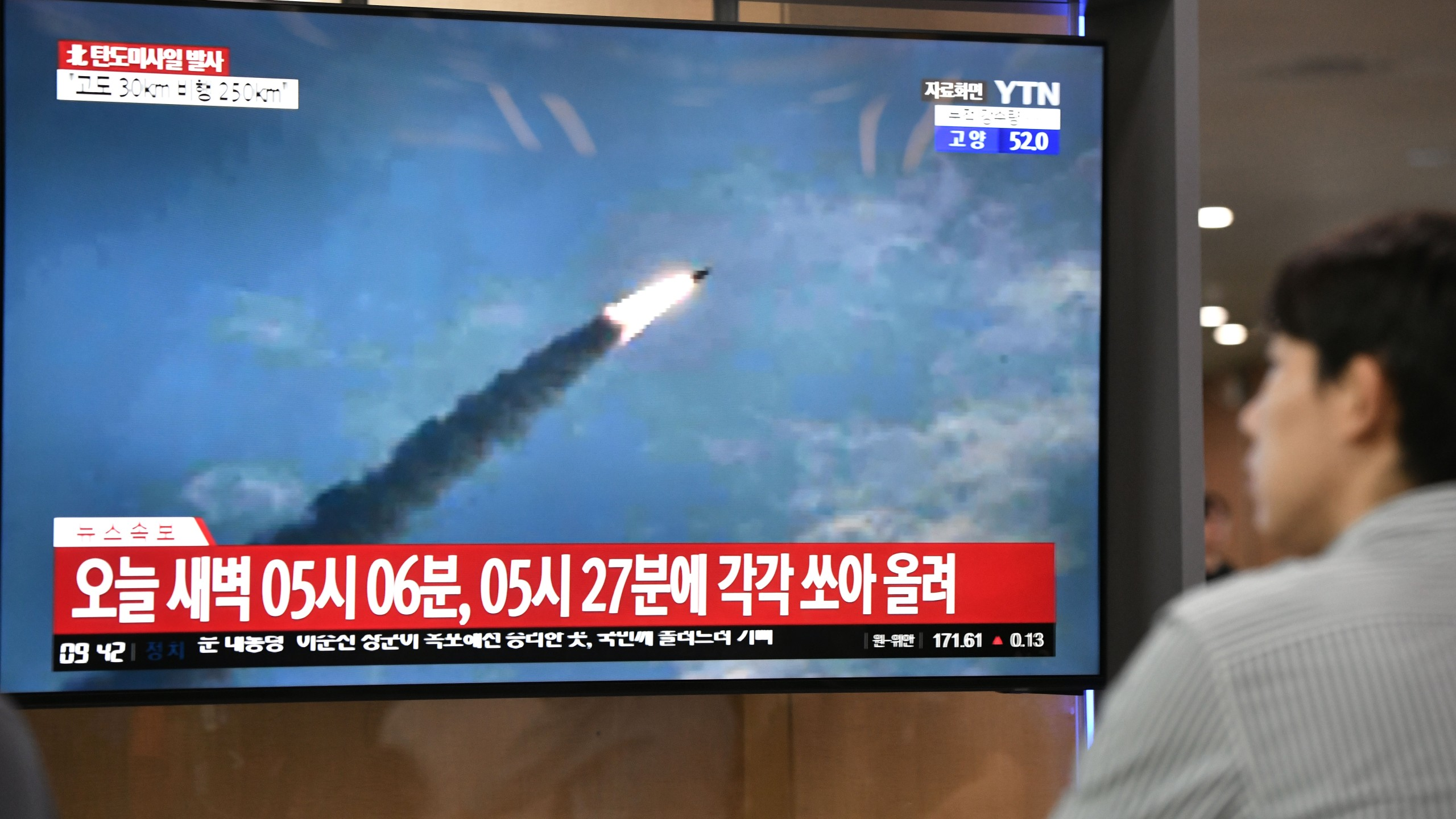 A man watches a television news screen showing file footage of a North Korean missile launch, at a railway station in Seoul on July 31, 2019. - Pyongyang fired two ballistic missiles on July 31, Seoul said, days after a similar launch that the nuclear-armed North described as a warning to the South over planned joint military drills with the United States. (Credit: JUNG YEON-JE/AFP/Getty Images)