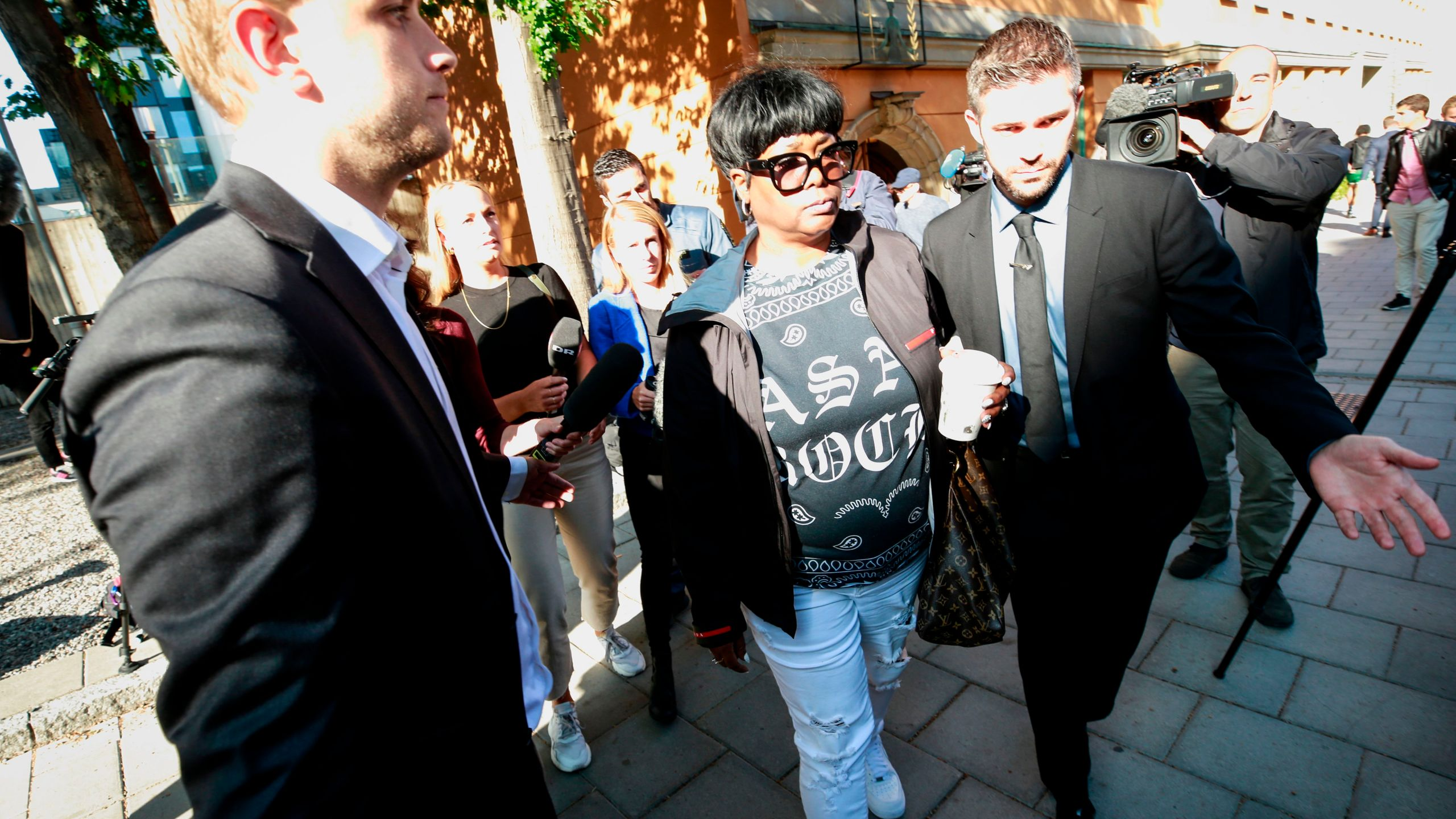 Renee Black (left), the mother of rapper A$AP Rocky leaves the district court after the second day of the rapper's trial over a June street brawl on Aug. 1, 2019 in Stockholm. (Credit: FREDRIK PERSSON/AFP/Getty Images)