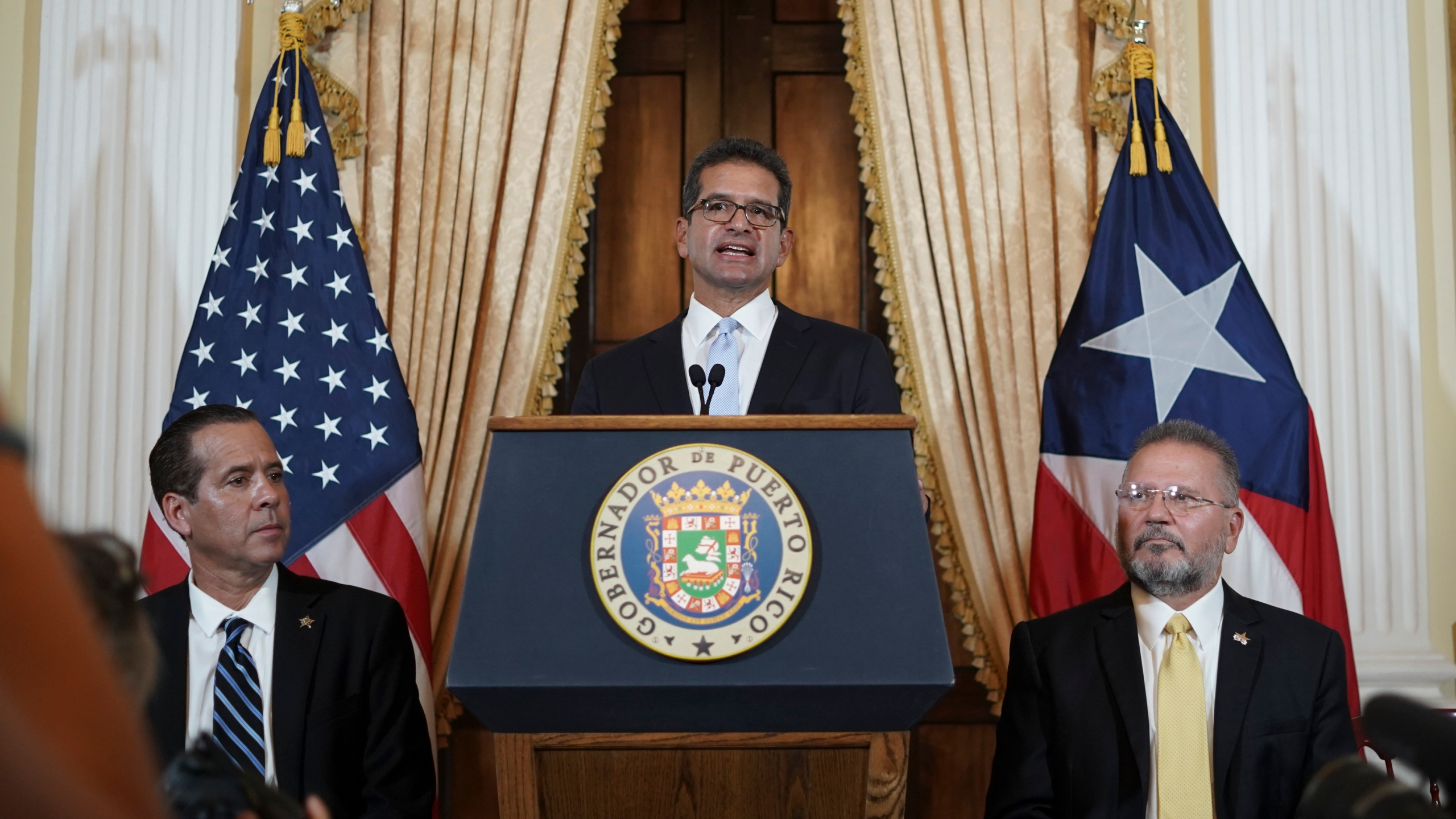 Pedro Pierluisi holds a press conference after being sworn in as governor of Puerto Rico in San Juan, Puerto Rico on, Aug. 2, 2019. (Credit: ERIC ROJAS/AFP/Getty Images)