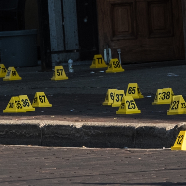 Police mark evidence after an active shooter opened fire in the Oregon district in Dayton, Ohio on August 4, 2019.(Credit: MEGAN JELINGER/AFP/Getty Images)