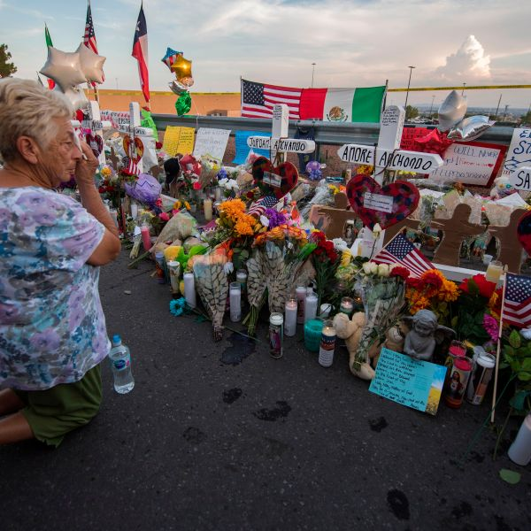 A woman prays at a makeshift memorial for victims of Walmart shooting that left a total of 22 people dead at the Cielo Vista Mall WalMart in El Paso, Texas, sometime in the days after the massacre on Aug. 5, 2019. (Credit: MARK RALSTON/AFP/Getty Images)