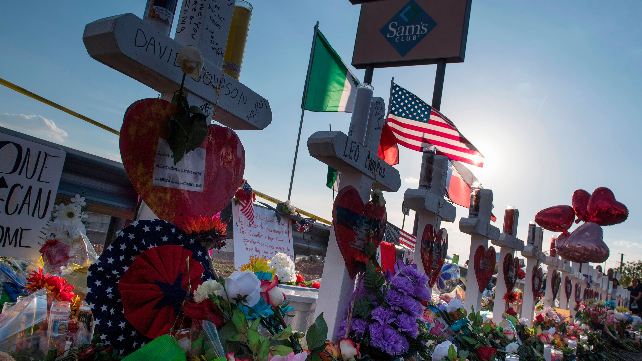 Crosses and flowers at a makeshift memorial for victims of Walmart shooting that left a total of 22 people dead at the Cielo Vista Mall WalMart in El Paso, Texas, on August 5, 2019. (Credit: MARK RALSTON/AFP/Getty Images)