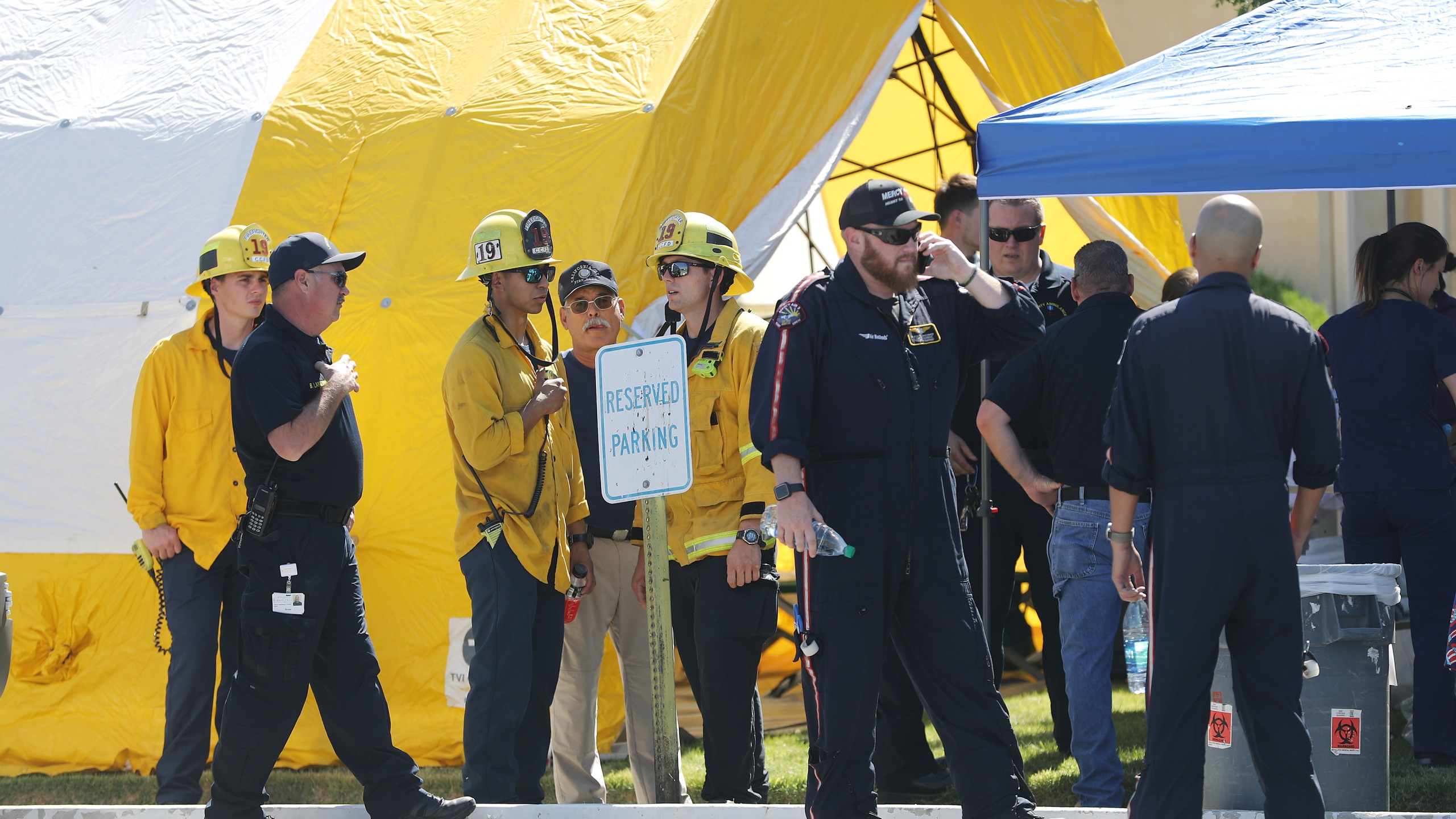 First responders gather in front of a tent set up outside Ridgecrest Regional Hospital after some patients were evacuated from the hospital following a 6.4 magnitude earthquake on July 4, 2019, in Ridgecrest, California. (Credit: Mario Tama/Getty Images)