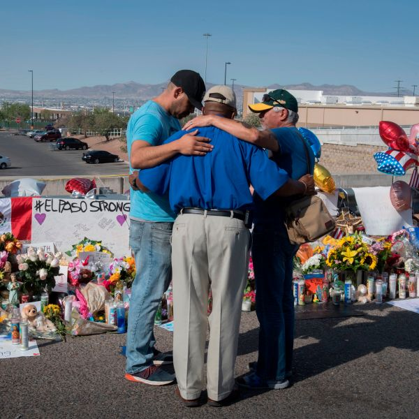 People pray at the makeshift memorial on Aug. 7, 2019, for victims of the shooting that left 22 people dead at a Walmart in El Paso, Texas. (Credit: Mark Ralston / AFP / Getty Images)