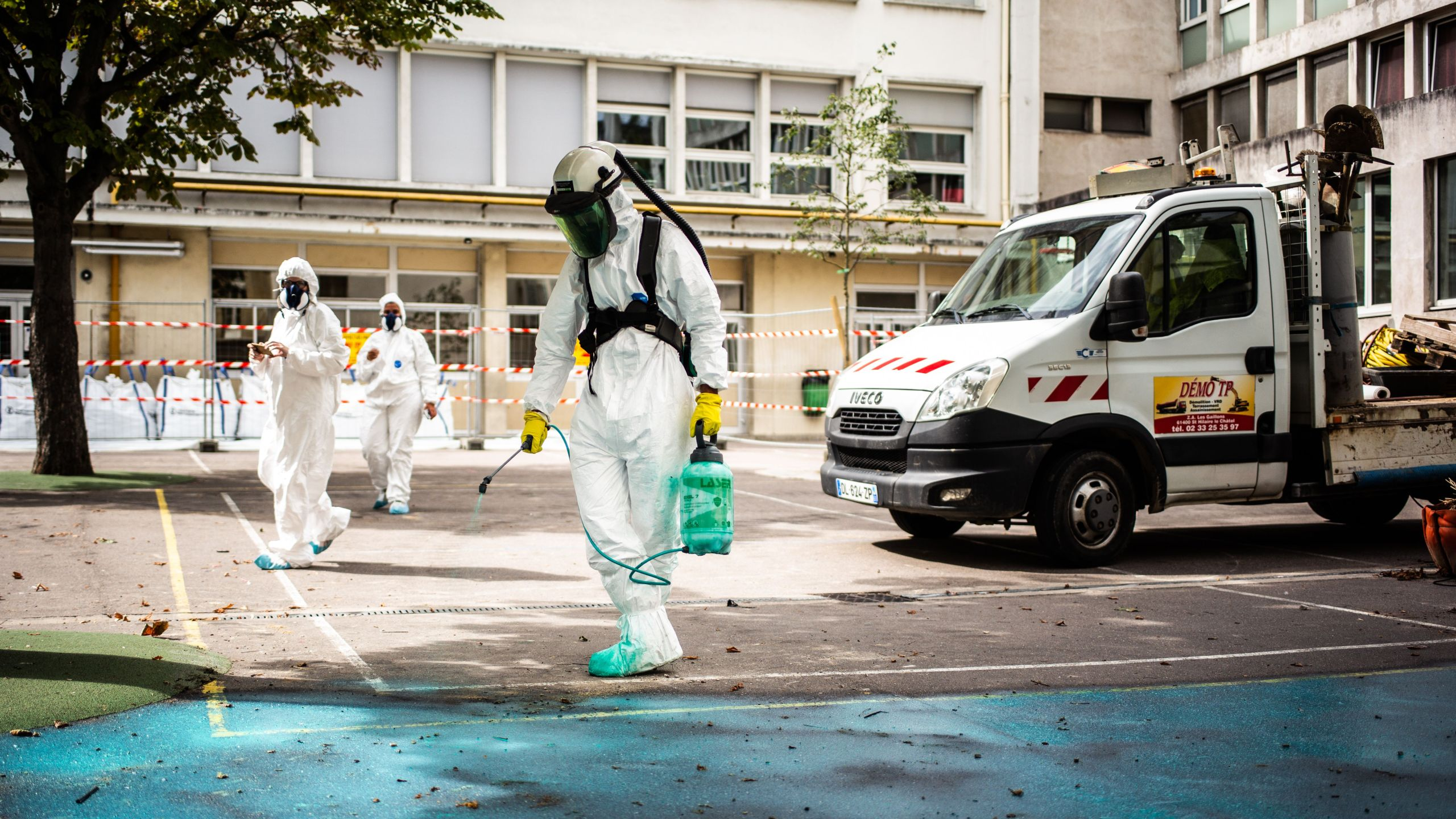 A worker sprays a gel on the ground to absorb lead as he takes part in a clean-up operation at Saint Benoit school near Notre-Dame cathedral in Paris during a decontamination work on Aug. 8, 2019. (Credit: MARTIN BUREAU/AFP/Getty Images)