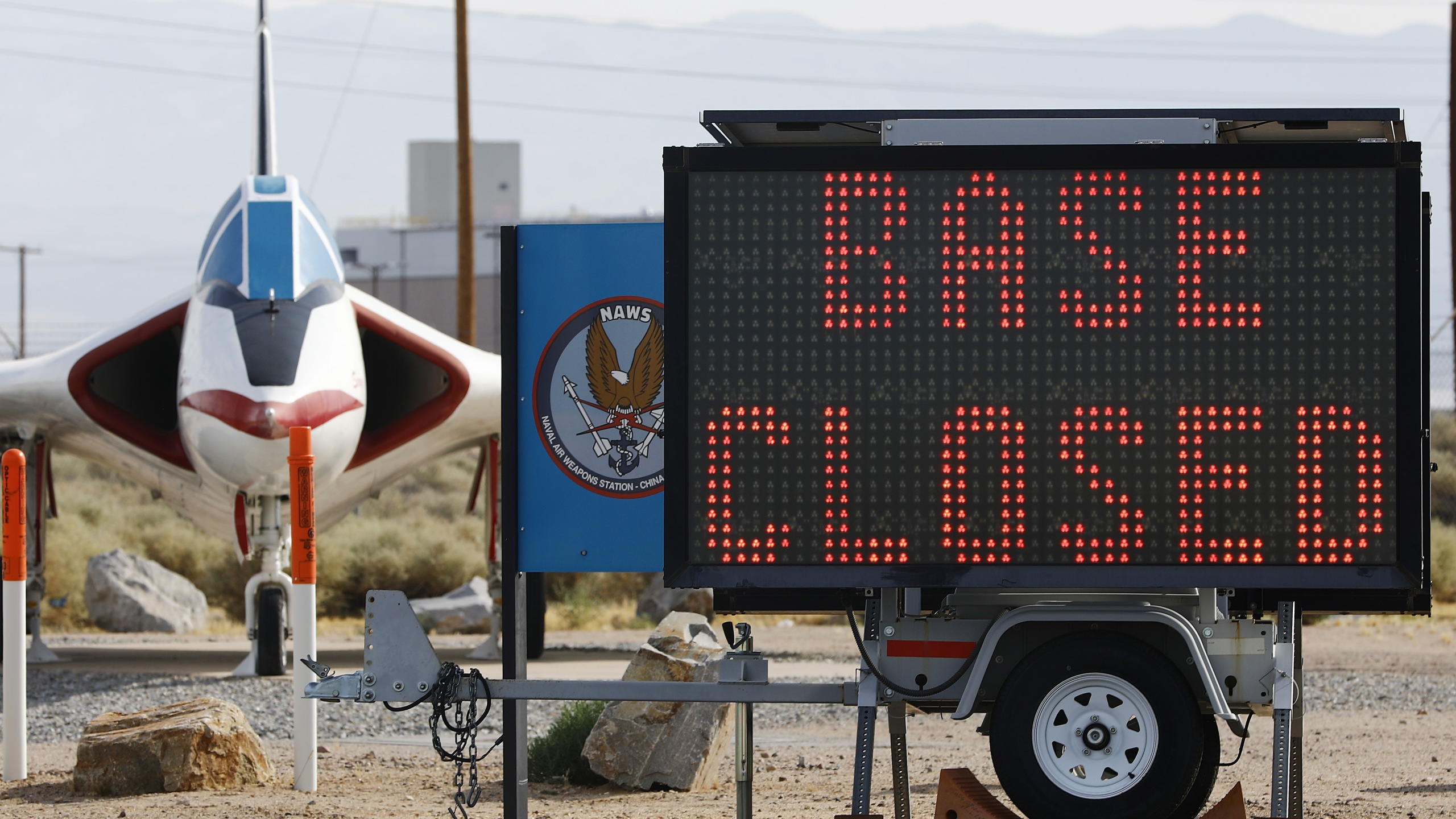 "A sign says ""Base Closed"" outside the main gate to Naval Air Weapons Station (NAWS) China Lake on July 7, 2019, in Ridgecrest, Calif. (Credit: Mario Tama/Getty Images)"