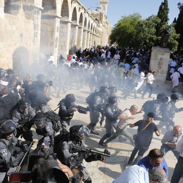 Israeli security forces fire sound grenades inside the Al-Aqsa Mosque compound in the Old City of Jerusalem on August 11, 2019, as clashes broke out during the overlapping Jewish and Muslim holidays of Eid al-Adha and the Tisha B'av holdiay inside the hisotric compound which is considered the third-holiest site in Islam and the most sacred for Jews, who revere it as the location of the two biblical-era temples. (Credit: AHMAD GHARABLI/AFP/Getty Images)
