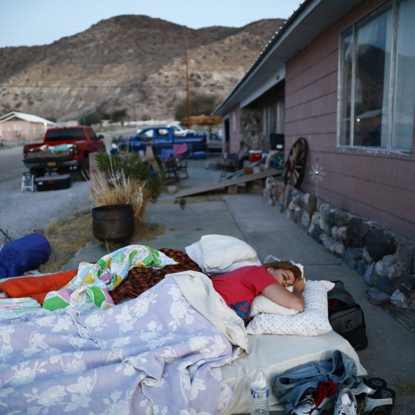 Chimene Jackson sleeps shortly after dawn outside her parents' home, which has been deemed uninhabitable due to structural damage from the recent 7.1 magnitude earthquake, on July 8, 2019 in Trona, Calif. (Credit: Mario Tama/Getty Images)