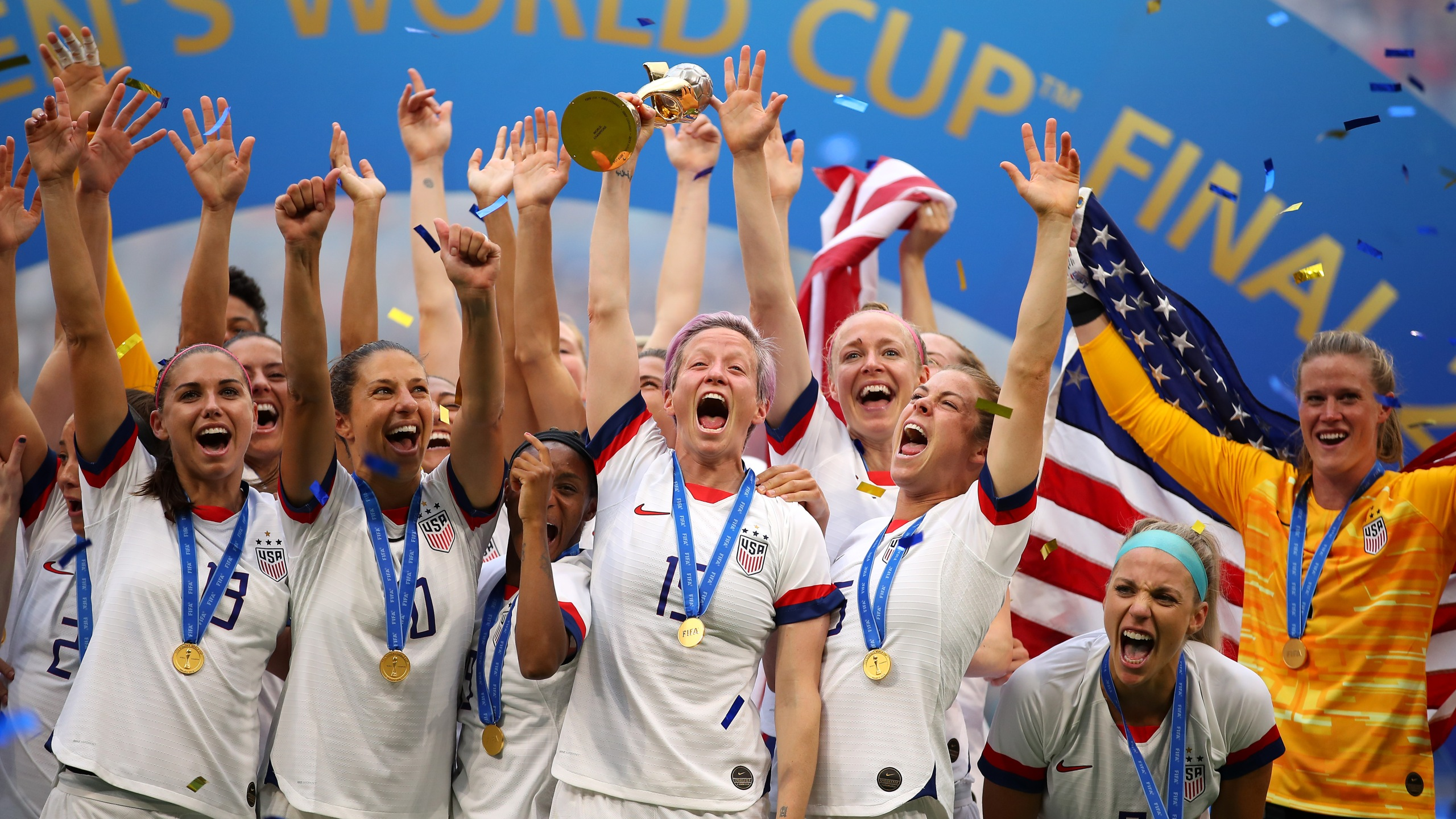 Megan Rapinoe lifts the trophy as the U.S. Women's National Soccer Team celebrates their victory during the 2019 FIFA Women's World Cup final match between the U.S. and the Netherlands on July 7, 2019, in Lyon, France. (Richard Heathcote/Getty Images)