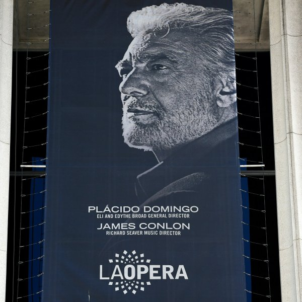 A banner showing the Los Angeles Opera's general director, Spanish tenor Placido Domingo, hangs from the Dorothy Chandler Pavilion on Aug. 13, 2019. (Credit: FREDERIC J. BROWN/AFP/Getty Images)
