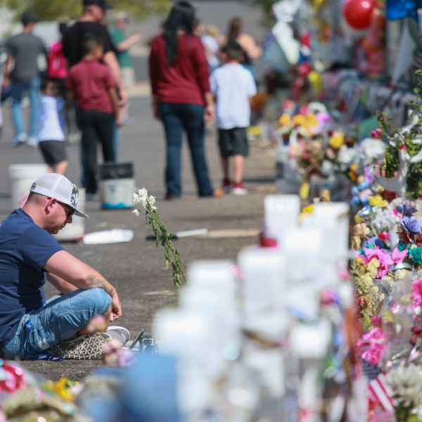 People gather at a makeshift memorial honoring victims outside Walmart in El Paso on Aug. 15, 2019.(Credit: Sandy Huffaker / Getty Images)