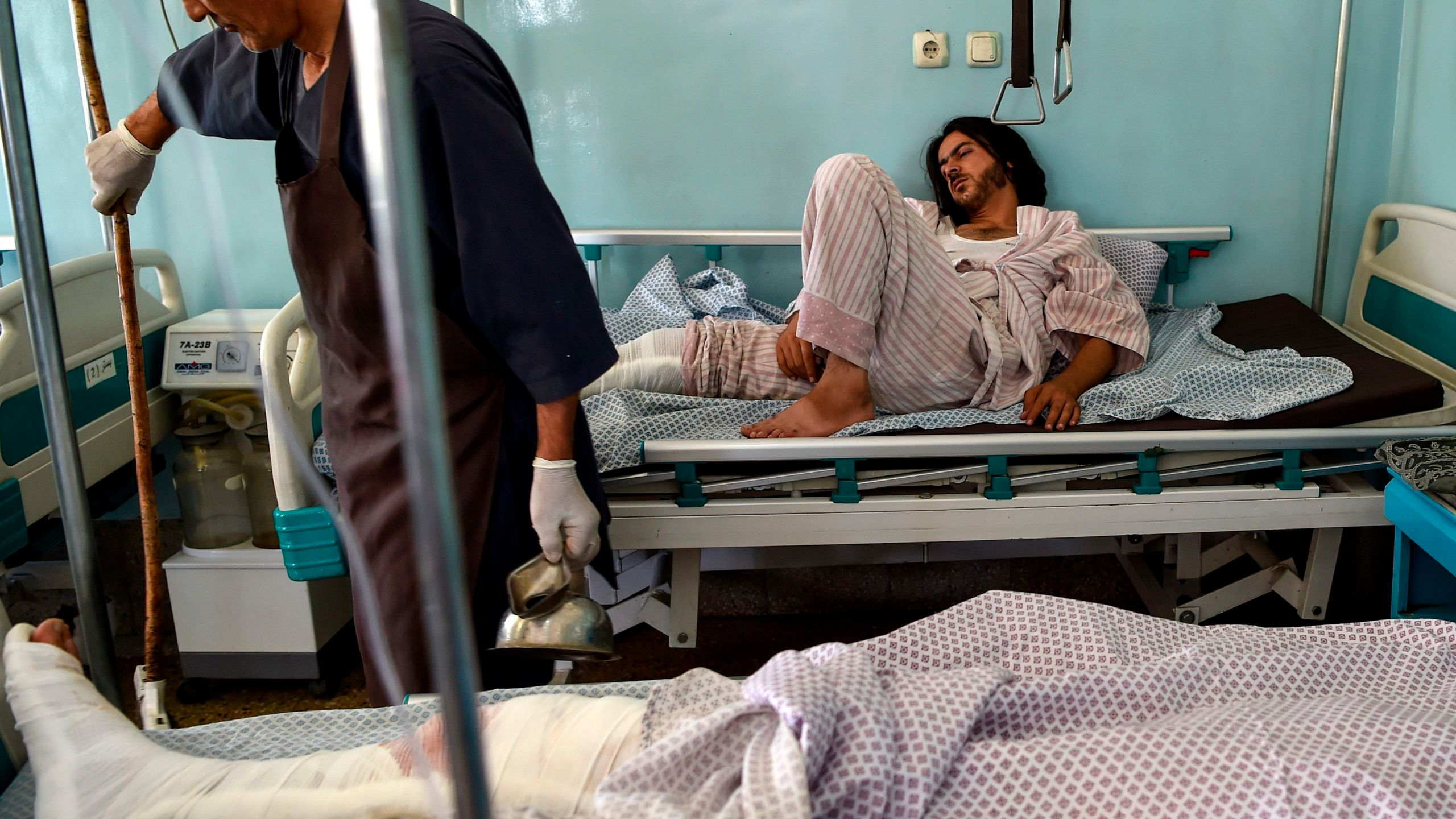 Wounded men receive treatment at the Wazir Akbar Khan hospital after a deadly bomb blast in a wedding hall in Kabul on Aug. 18, 2019. (Credit: WAKIL KOHSAR/AFP/Getty Images)