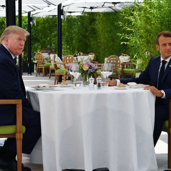 Donald Trump sits with Emmanuel Macron at the Hotel du Palais in Biarritz, south-west France on Aug. 24, 2019, on the first day of the annual G-7 Summit. (Credit: NICHOLAS KAMM/AFP/Getty Images)