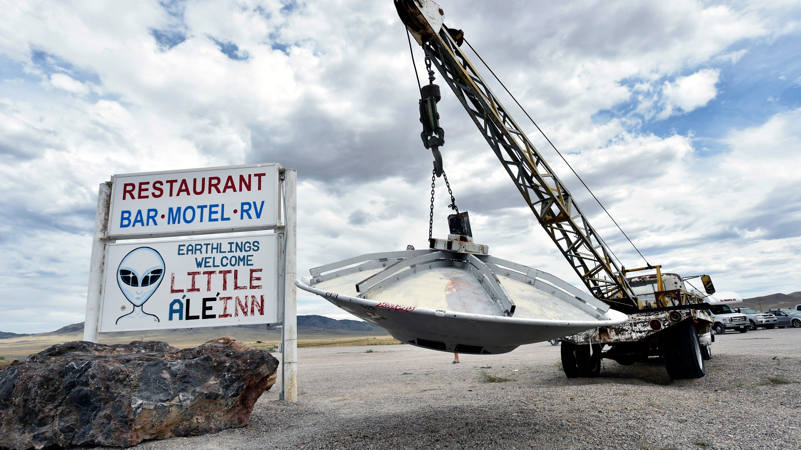 Roadside artwork featuring a tow truck and a flying saucer is displayed at the Little A'le' Inn restaurant and gift shop on July 22, 2019, in Rachel, Nevada. (Credit: David Becker/Getty Images)