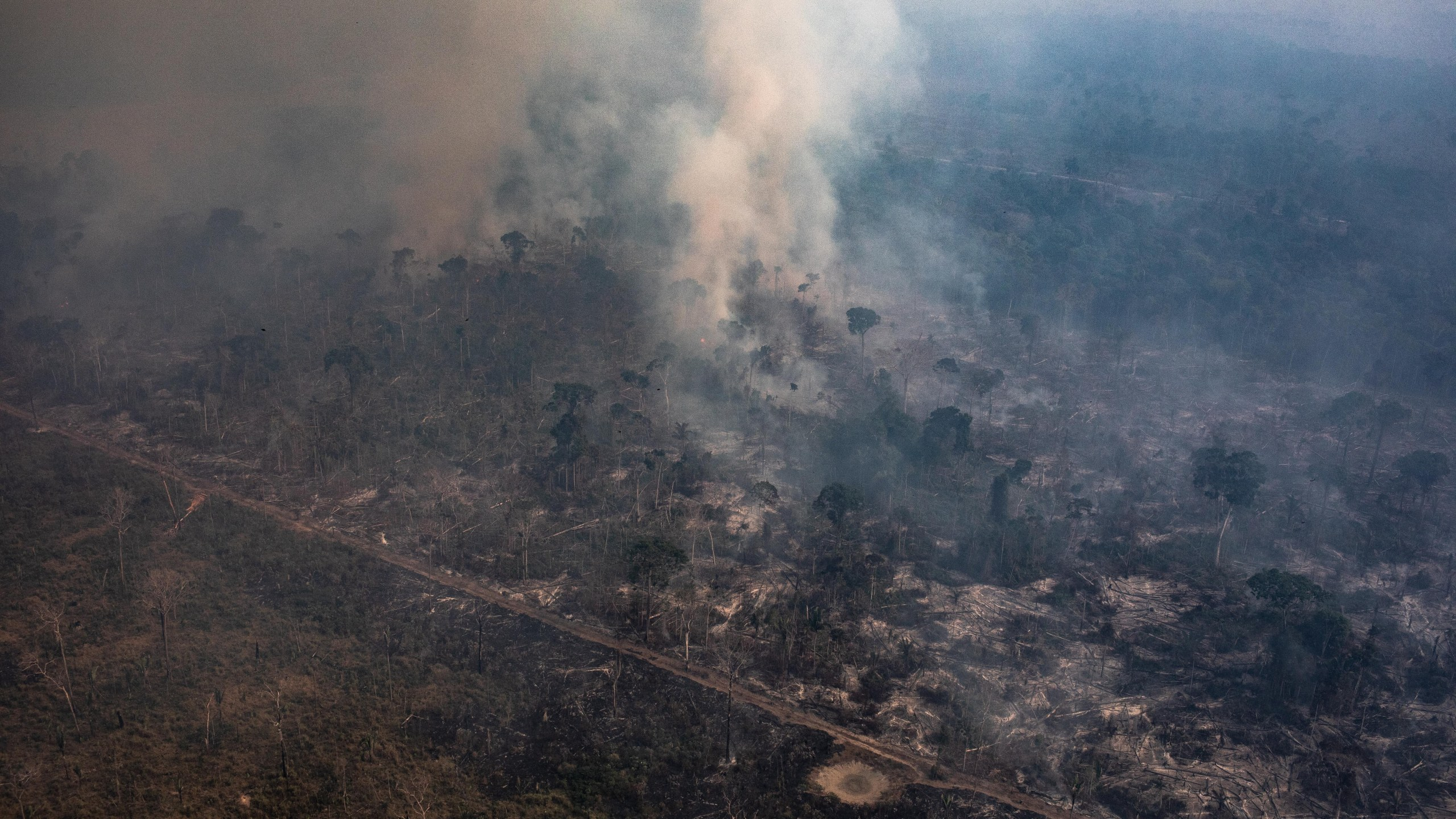 In this aerial image, a fire burns in a section of the Amazon rainforest on Aug. 25, 2019, in the Candeias do Jamari region near Porto Velho, Brazil. (Credit: Victor Moriyama/Getty Images)