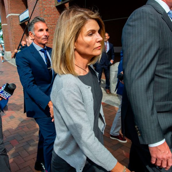 Actress Lori Loughlin and husband Mossimo Giannulli exit the Boston Federal Court house after a pre-trial hearing with Magistrate Judge Kelley at the John Joseph Moakley US Courthouse in Boston on Aug. 27, 2019. (Credit: JOSEPH PREZIOSO/AFP/Getty Images)