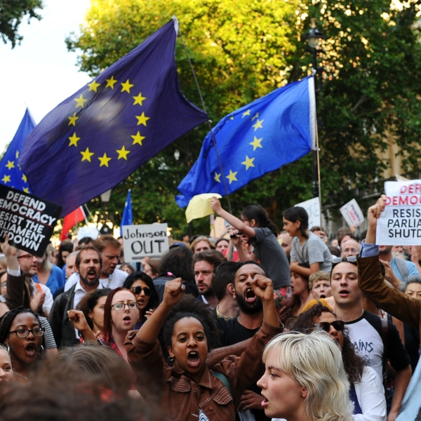 Demonstrators wave European Union flags and hold placards as they protest outside of Downing Street in London on August 28, 2019. (Credit: DANIEL SORABJI/AFP/Getty Images)