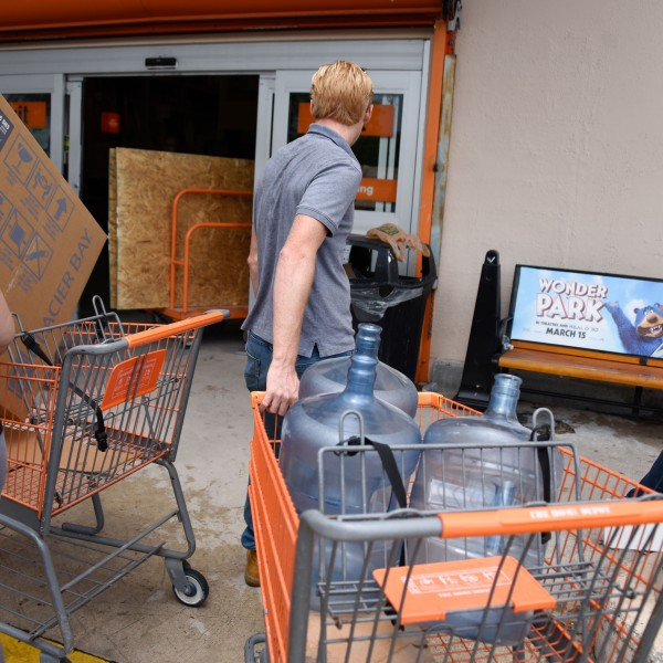 Residents are sighted at Home Depot where they are buying plywood and bottled water on August 29, 2019, as they prepare for Hurricane Dorian. (Credit: MICHELE EVE SANDBERG/AFP/Getty Images)